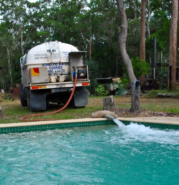 Pomoma Water truck filling a pool